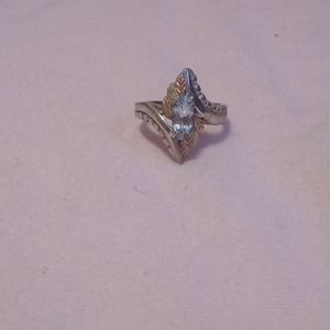 Gold ring with pale blue stone